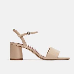 Patent heeled sandal
